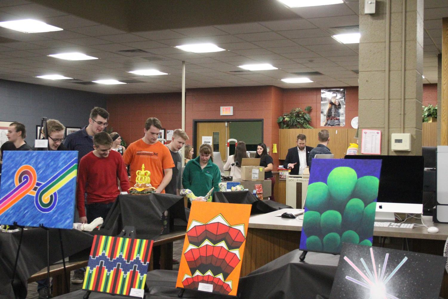 Artworks are showcased in the Literary Magazine Show.