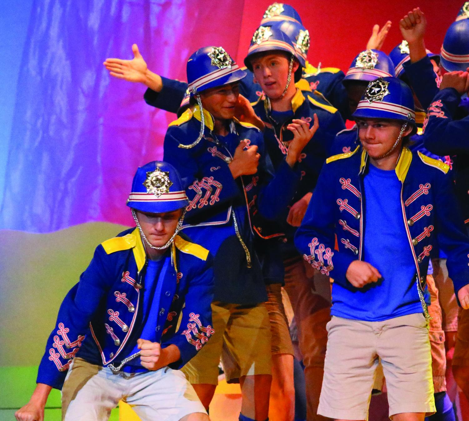 The boy scouts in Seussical sing and dance