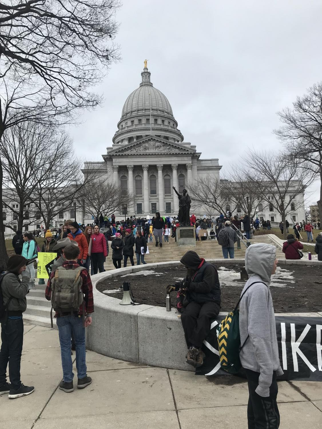 Students gather outside the Wisconsin Capitol in protest of the lack of climate change regulations. Photo courtesy of Sydnie Oestreich.