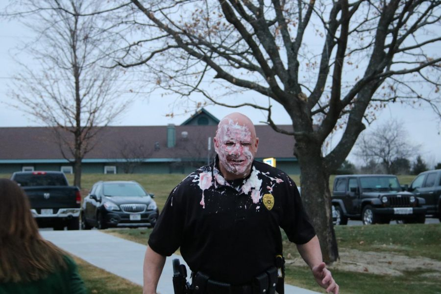 Officer Frank after being pied by a representative for DCE staff. Photo by Rachel Reinke