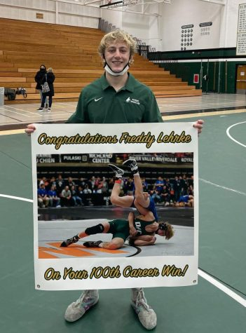 Wrestling seems to run in the Lehrke family.  Freddy Lehrke displays the moment he achieved his 100th win.